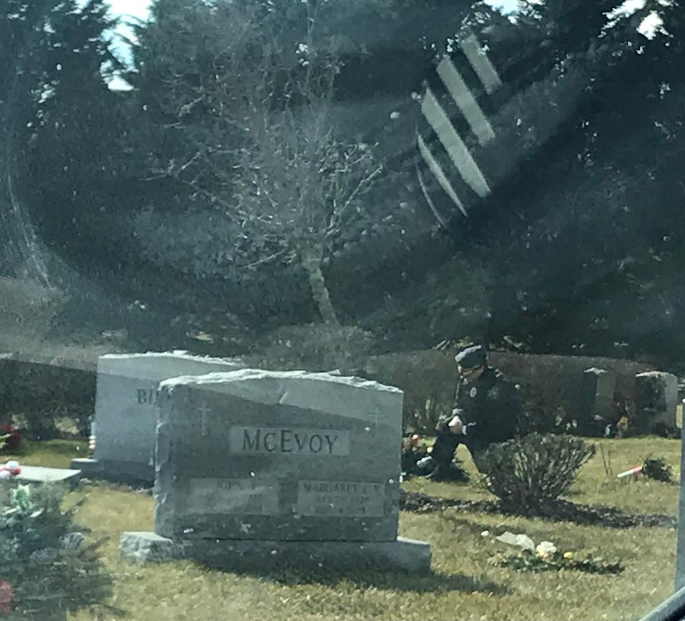While Joe Biden gave his inauguration speech on Wednesday afternoon, a lone man in a blue uniform kneeled at the grave of Biden's son Beau Biden at St. Joseph on the Brandywine church in Greenville, Del.