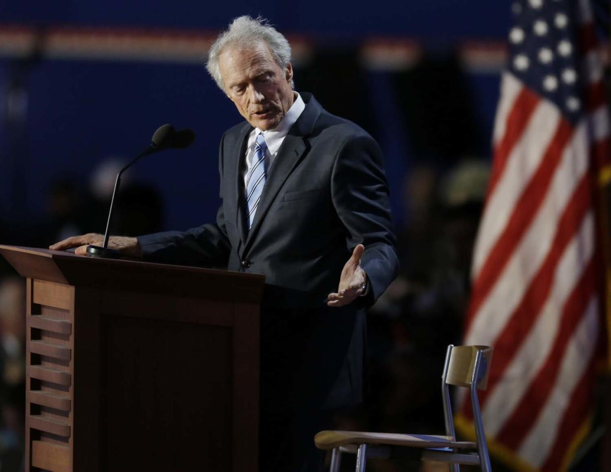 FILE - In this Aug. 30, 2012 file photo, actor Clint Eastwood speaks to an empty chair while speaking to delegates at the Republican National Convention in Tampa, Fla. Campaign 2012 is rich with images that conjure the seriousness and silliness that unfold side-by-side in any presidential race. Sad to say, Eastwood's rambling conversation with an empty chair representing Obama during the GOP convention may well be the single most memorable moment of the 2012 presidential campaign. And the only candidate in that tableau was invisible. (AP Photo/Lynne Sladky, File)