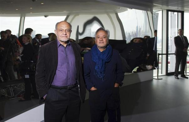 The designers of the ArcelorMittal Orbit, Cecil Balmond (L) and Anish Kapoor, pose for photographs at the top of the ArcelorMittal Orbit in the London 2012 Olympic Park in east London May 11, 2012.