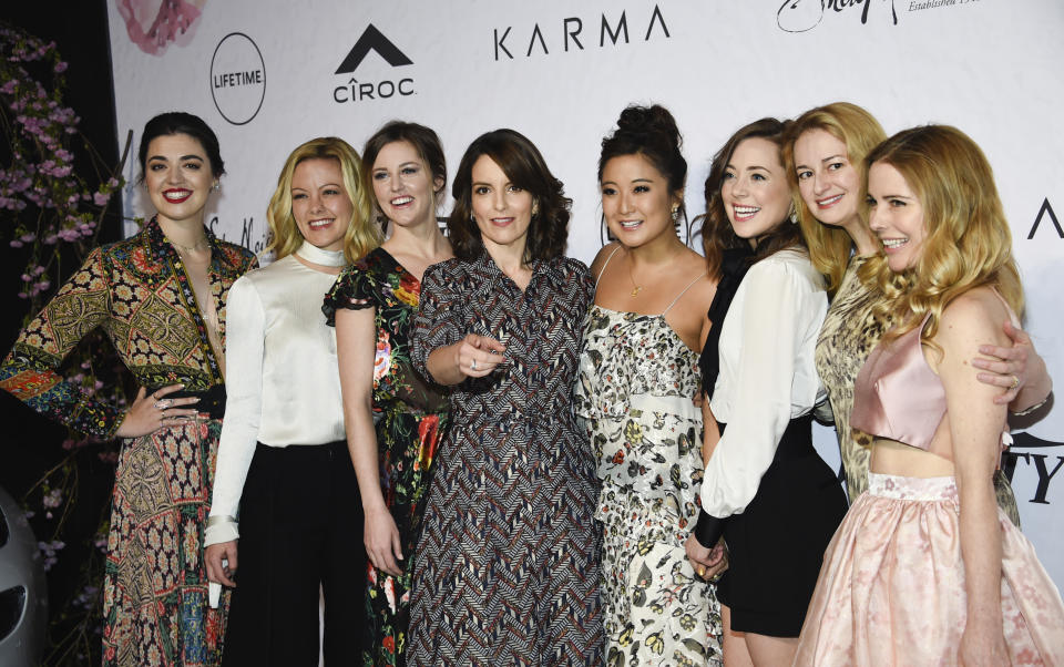 """Honoree Tina Fey, center, surrounded by the cast of Broadway's """"Mean Girls"""", from left, Barrett Wilbert Weed, Kate Rockwell, Taylor Louderman, Ashley Park, Erika Henningsen, screenwriter Nell Benjamin and actress Kerry Butler at Variety's Power of Women: New York event at Cipriani Wall Street on Friday, April 13, 2018, in New York. (Photo by Evan Agostini/Invision/AP)"""