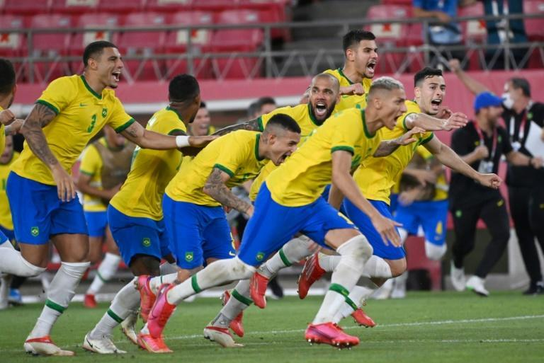 Brazil players celebrate their win over Mexico on penalties