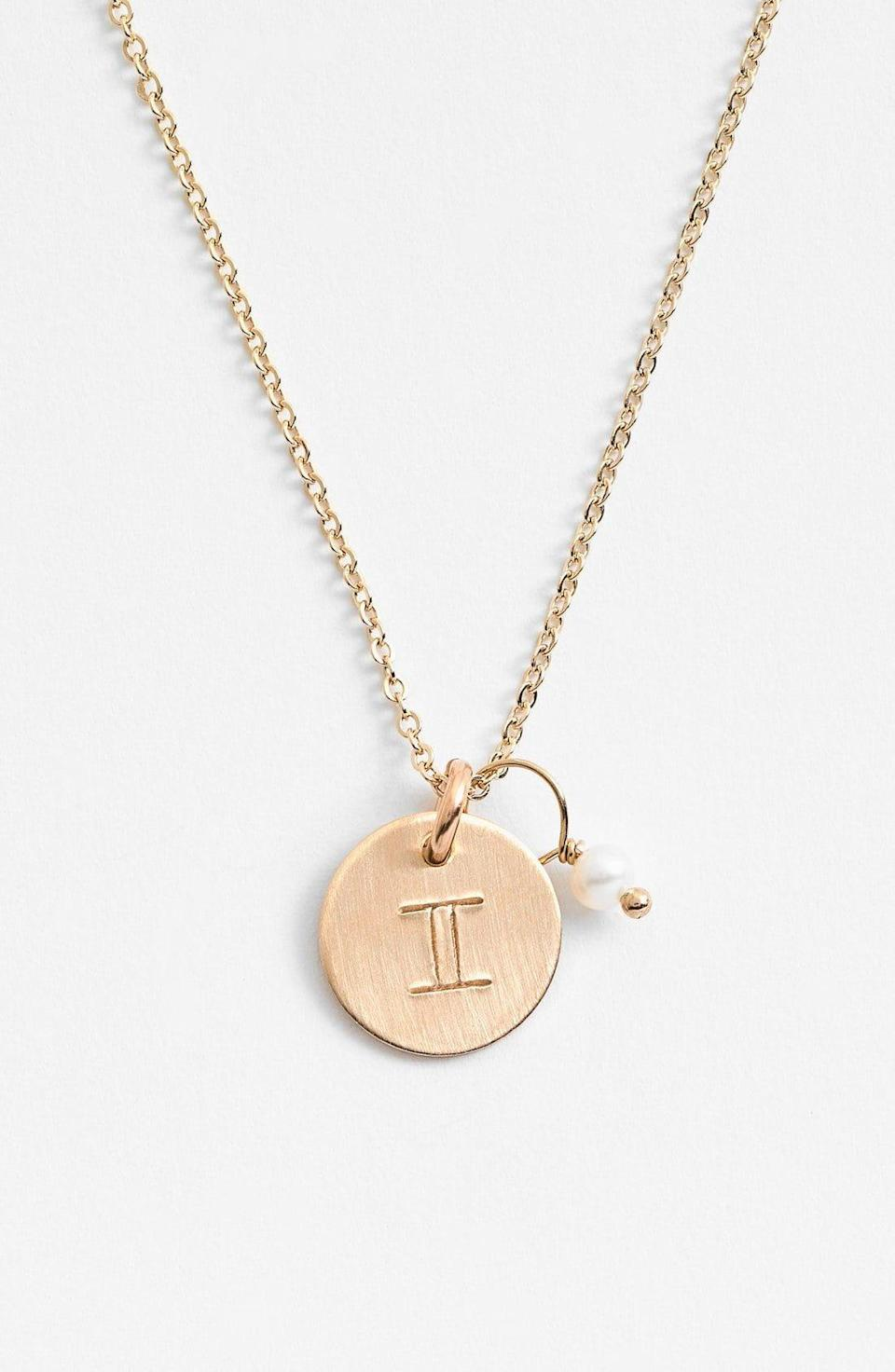 """<p><strong>NASHELLE</strong></p><p>nordstrom.com</p><p><strong>$70.00</strong></p><p><a href=""""https://go.redirectingat.com?id=74968X1596630&url=https%3A%2F%2Fwww.nordstrom.com%2Fs%2Fnashelle-14k-gold-fill-semiprecious-birthstone-zodiac-mini-disc-necklace%2F3818518&sref=https%3A%2F%2Fwww.cosmopolitan.com%2Flifestyle%2Fg31699444%2Fgemini-gift-guide%2F"""" rel=""""nofollow noopener"""" target=""""_blank"""" data-ylk=""""slk:Shop Now"""" class=""""link rapid-noclick-resp"""">Shop Now</a></p><p>Show your pal that being a Gemini is something to brag about! A necklace that showcases the classic symbol of the twins is ideal for a friend who's proud AF to be a Gemini. It's also a fabulous conversation starter for the astro buffs.</p>"""