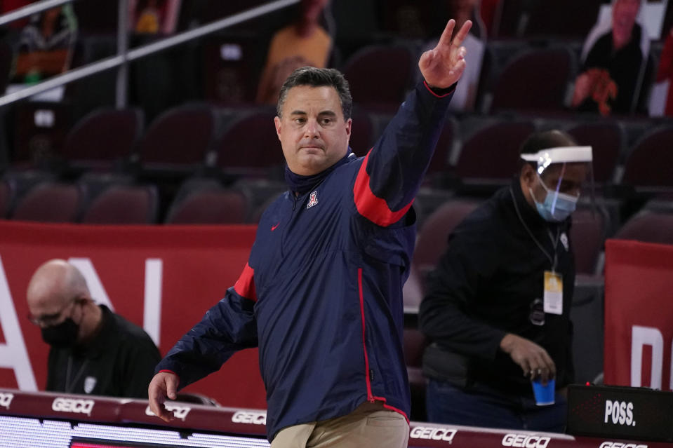 Arizona head coach Sean Miller waves after a win over Southern California during an NCAA college basketball game Saturday, Feb. 20, 2021, in Los Angeles. (AP Photo/Marcio Jose Sanchez)