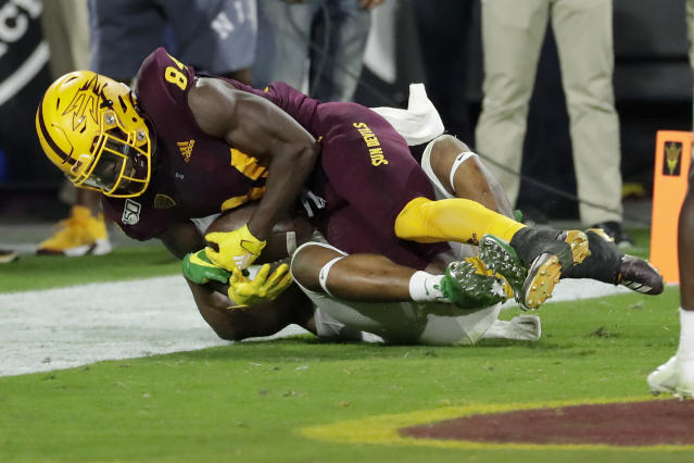 Arizona State wide receiver Frank Darby, top, pulls in a touchdown catch as Oregon cornerback Deommodore Lenoir defends during the second half of an NCAA college football game, Saturday, Nov. 23, 2019, in Tempe, Ariz. Arizona State won 31-28. (AP Photo/Matt York)