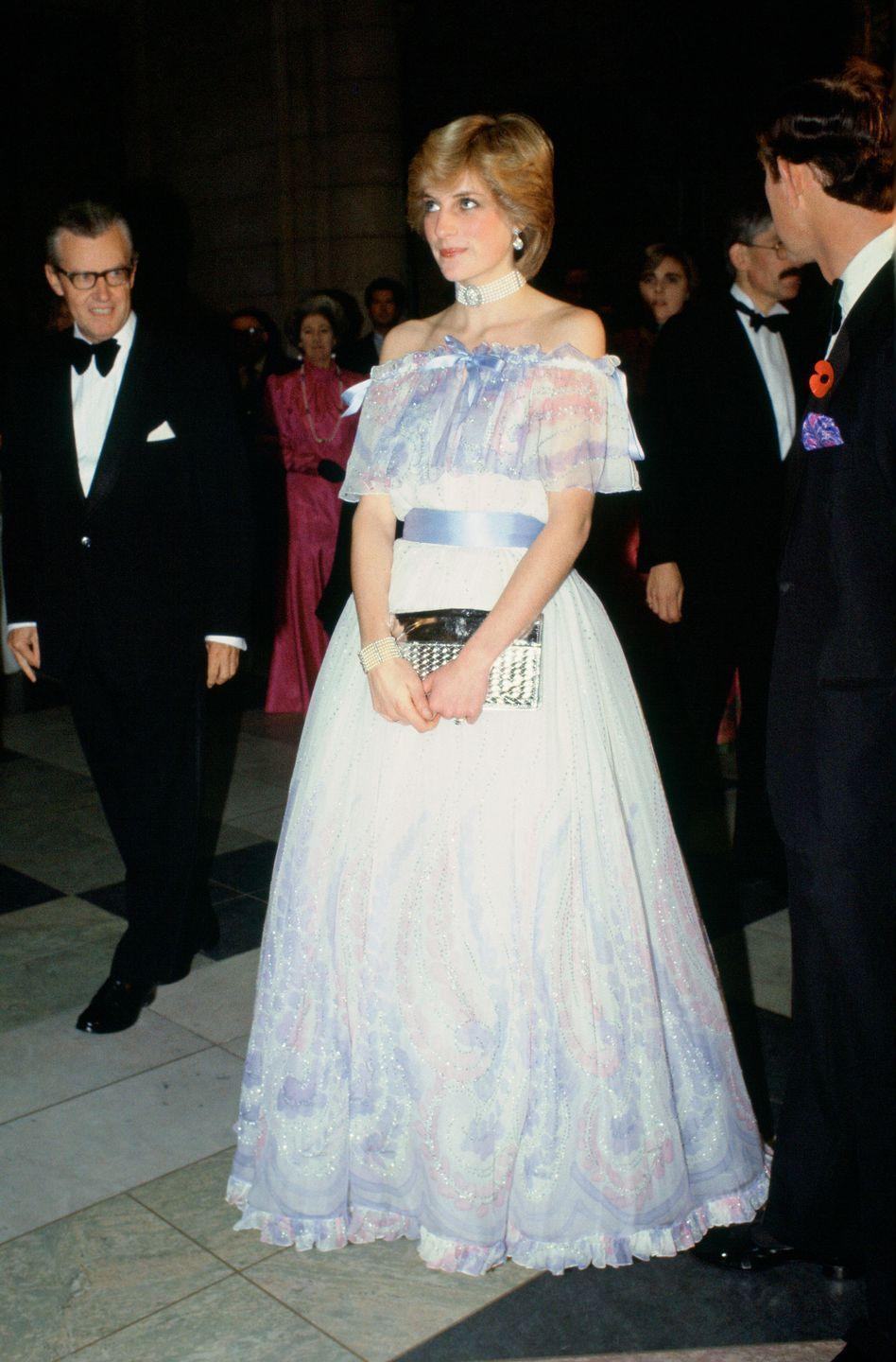 <p>Princess Diana wore an off-the-shoulder chiffon evening gown, designed by Bellville Sassoon, in 1981. The Princess was famously photographed asleep while attending the event and, as a result, the palace revealed she was expecting her first child. </p>