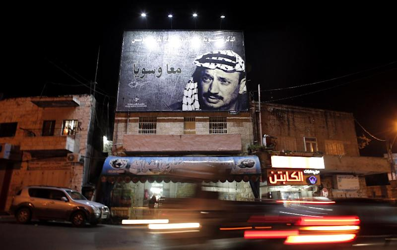 A picture taken on November 3, 2014, shows a giant portrait of late Palestinian leader Yasser Arafat displayed on a street in the Arab east Jerusalem neighbourhood of Beit Hanina (AFP Photo/Ahmad Gharabli)