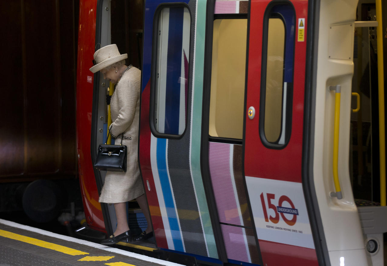 Britain's Queen Elizabeth II steps off a parked train she was shown at Baker Street underground station in London, for a visit to mark the 150th anniversary of the London Underground, Wednesday, March 20, 2013.  The Queen made her first public engagement in more than a week Wednesday following her hospitalization for a stomach bug.  The British head of state joined her husband Prince Philip and their granddaughter-in-law, Kate Duchess of Cambridge, for the event marking the 150th anniversary of London's sprawling subway system, affectionately known as the Tube.  (AP Photo/Matt Dunham)