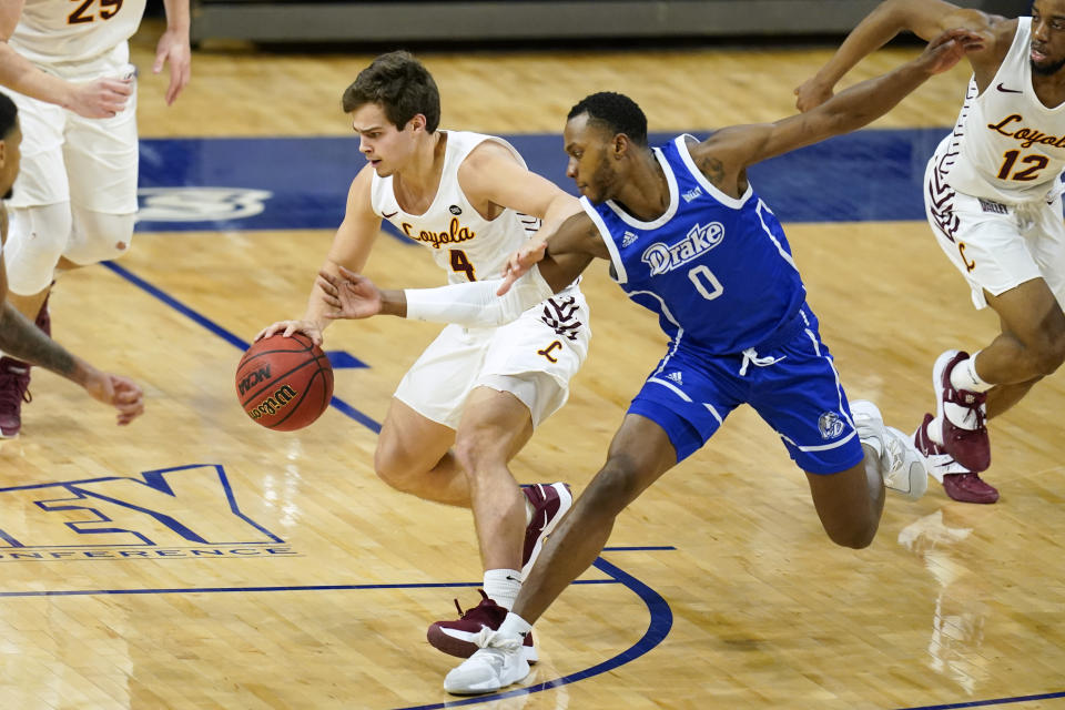 Loyola of Chicago guard Braden Norris (4) fights for a loose ball with Drake guard D.J. Wilkins (0) during the first half of an NCAA college basketball game, Sunday, Feb. 14, 2021, in Des Moines, Iowa. (AP Photo/Charlie Neibergall)