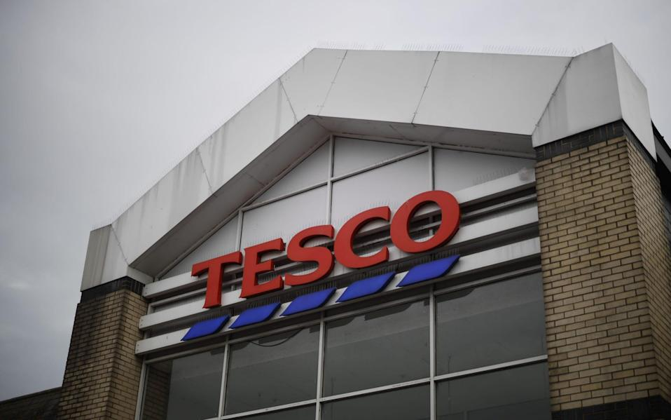 In this file photo taken on September 30, 2019 Signage is seen outside a Tesco Superstore in south London - Tolga Akmen/AFP
