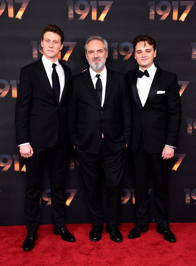 Sir Sam Mendes with the stars of 1917, George MacKay (left) and Dean-Charles Chapman