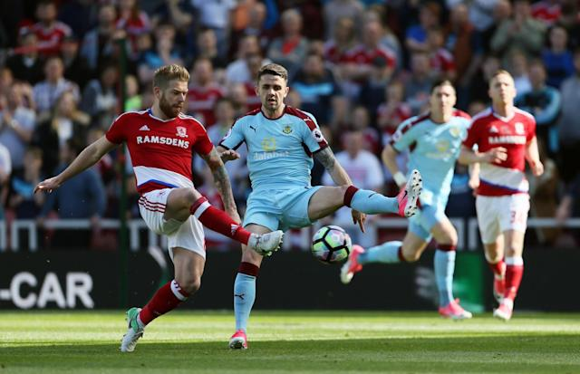 <p>Middlesbrough's Adam Clayton (left) and Burnley's Robbie Brady battle for the ball</p>