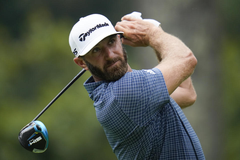 Dustin Johnson tees off from the second hole during the third round of the BMW Championship golf tournament, Saturday, Aug. 28, 2021, at Caves Valley Golf Club in Owings Mills, Md. (AP Photo/Julio Cortez)