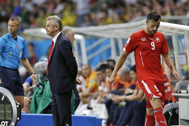 Switzerland's Haris Seferovic (9) walks past his coach Ottmar Hitzfeld after France scored their fifth goal during the group E World Cup soccer match between Switzerland and France at the Arena Fonte Nova in Salvador, Brazil, Friday, June 20, 2014. (AP Photo/Natacha Pisarenko)