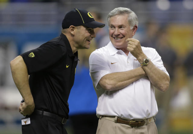 Oregon coach Mark Helfrich, left, talks with Texas coach Mack Brown, right, before the Valero Alamo Bowl NCAA college football game, Monday, Dec. 30, 2013, in San Antonio. (AP Photo/Eric Gay)