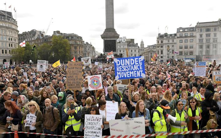 People take part in a 'We Do Not Consent' rally at Trafalgar Square in London, organised by Stop New Normal, to protest against coronavirus restrictions - Stefan Rousseau /PA