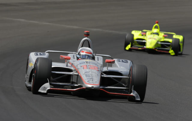 Will Power, of Australia, leads Simon Pagenaud, of France, though the first turn during the Indianapolis 500 auto race at Indianapolis Motor Speedway, in Indianapolis Sunday, May 27, 2018. (AP Photo/AJ Mast)
