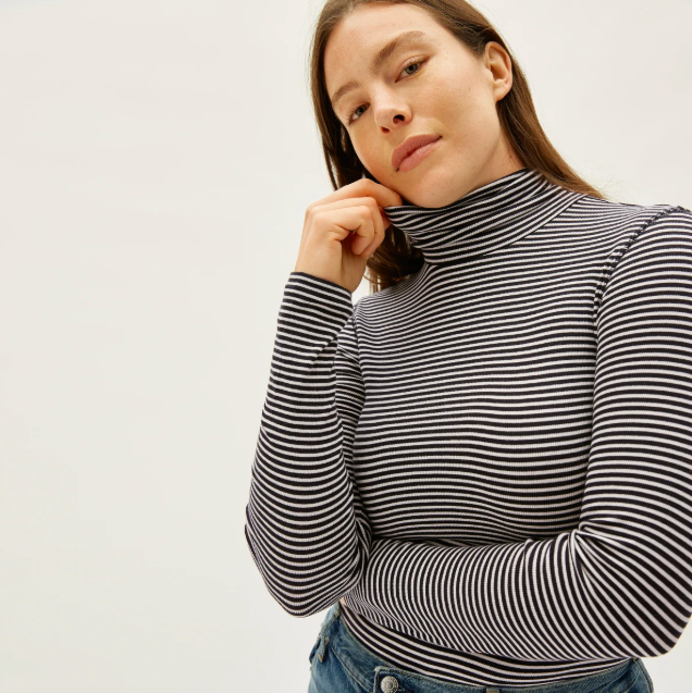 The Pima Micro-Rib Turtleneck in Black / Bone. Image via Everlane.
