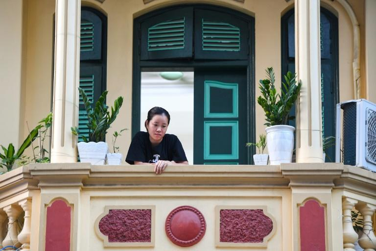 Overlooking deserted streets, Hanoi's tiny balconies have become places of refuge for the city's locked-down residents (AFP/Nhac NGUYEN)