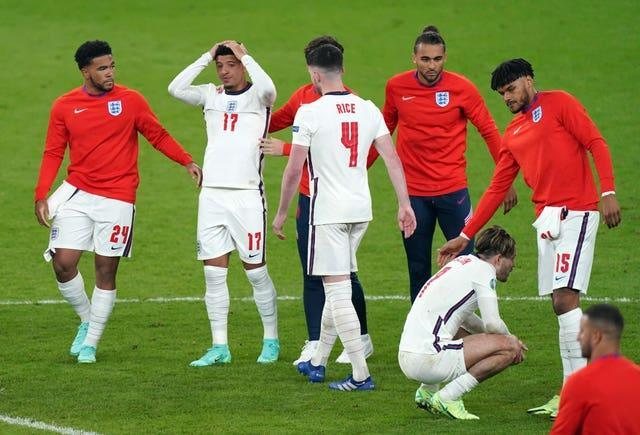 Jason Sancho is consoled by England team-mates