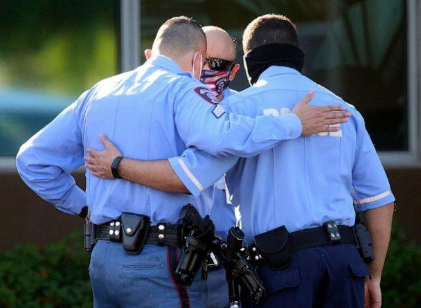 PHOTO: McAllen Police officers console one another as they gather outside the McAllen Medical Center, July 11, 2020, in McAllen, Texas. (Joel Martinez/The Monitor via AP)