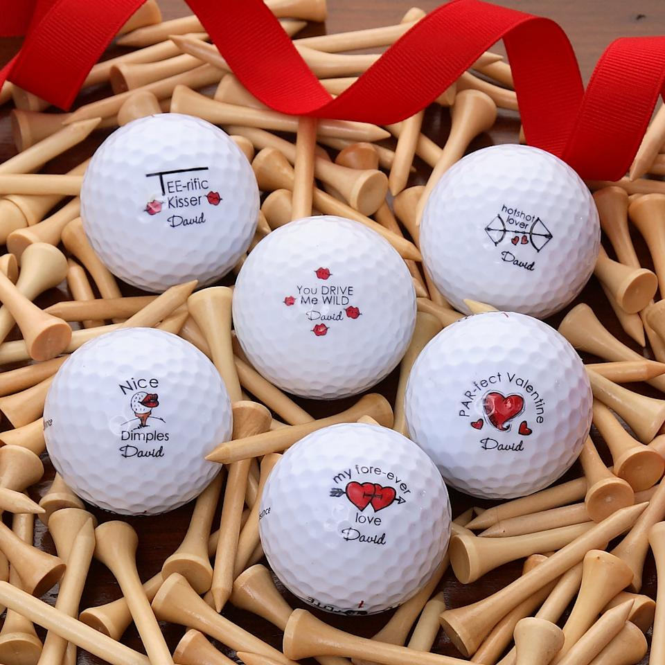 Personalized Loving Hearts Golf Ball Set of 12. Image via Personalization Mall.