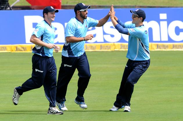 PRETORIA, SOUTH AFRICA - OCTOBER 10: Andre Adams of Auckland celebrates the wicket of Shahid Afridi with his team mates during the Karbonn Smart CLT20 Champions League Twenty20 pre-tournament Qualifying Stage match between Hampshire Royals (England) and Auckland Aces (New Zealand) at SuperSport Park on October 10, 2012 in Pretoria, South Africa. (Photo by Lee Warren / Gallo Images/Getty Images)