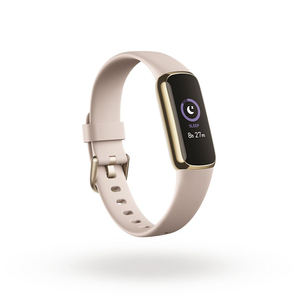Product render of Fitbit Luxe, 3QTR view, in Lunar White and Soft Gold.