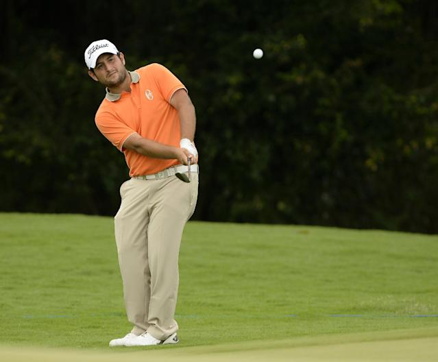 In this photo released by OneAsia, Alexander Levy of France plays a shot during the second round of the Volvo China Open at Genzon Golf Club in Shenzhen, southern China Friday, April 25, 2014. (AP Photo/OneAsia, Paul Lakatos)
