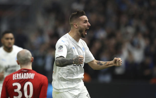Marseille's Dario Benedetto celebrates after scoring his side's second goal during the French League One soccer match between Marseille and Nimes at the Velodrome stadium in Marseille, southern France, Saturday, Dec. 21, 2019. (AP Photo/Daniel Cole)