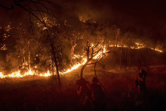 <p>Inmate firefighters battle a wildfire near Oroville, Calif., on Saturday, July 8, 2017. The fast-moving wildfire in the Sierra Nevada foothills destroyed structures, including homes, and led to several minor injuries, fire officials said Saturday as blazes threatened homes around California during a heat wave. (AP Photo/Noah Berger) </p>