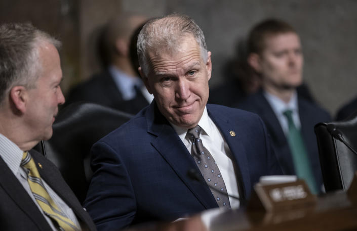 Sen. Thom Tillis, R-N.C., joined at left by Sen. Dan Sullivan, R-Alaska, attends a Senate Armed Services hearing on Capitol Hill in Washington, prior to the vote on President Donald Trump's national emergency at the border, Thursday, March 14, 2019. Changing his vote from the public stance he took last month, Tillis voted to support President Donald Trump's declaration of a national emergency to pay for his border wall. (AP Photo/J. Scott Applewhite)