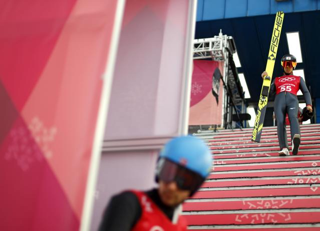 Nordic Combined Events - Pyeongchang 2018 Winter Olympics - Ski Jumping Training - Alpensia Ski Jumping Centre - Pyeongchang, South Korea - February 19, 2018 - Akito Watabe of Japan arrives for his jump. REUTERS/Dominic Ebenbichler