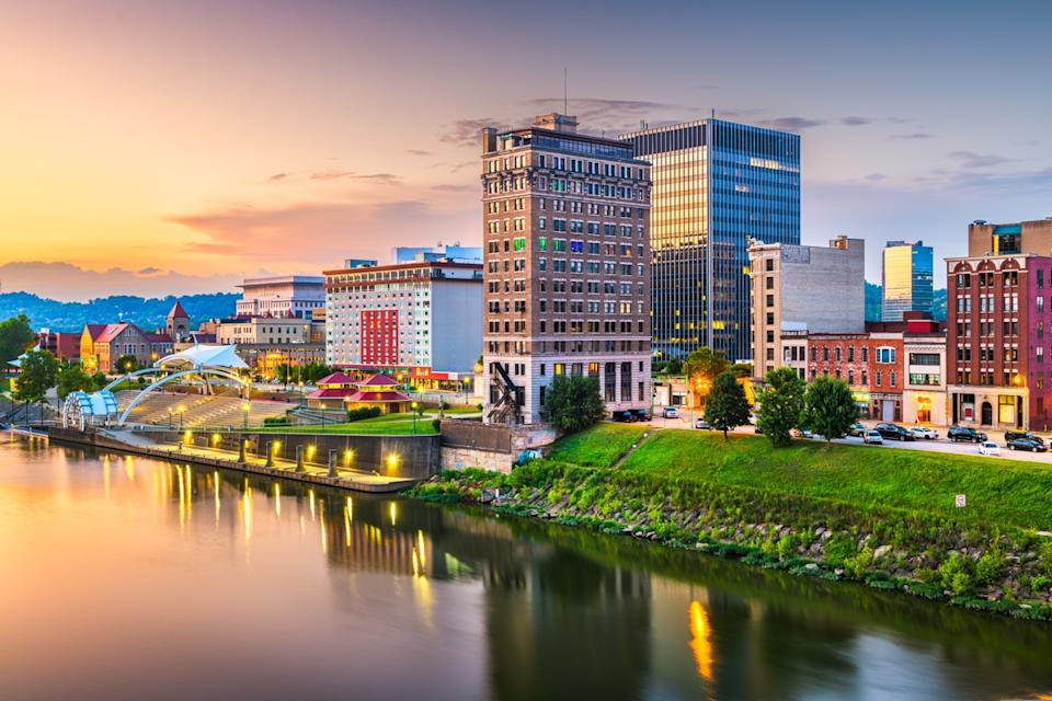 city skyline and river in downtown Charleston, West Virginia at dusk