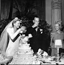 <p>A just-married couple (circa 1941) raises a glass in celebration. The bride stunned in a very tailored dress, complete with strong shoulders. </p>