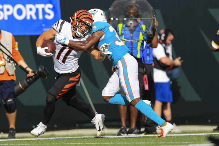 Cincinnati Bengals wide receiver Trent Taylor (11) is tackled by Miami Dolphins cornerback Jamal Perry (33) in the second half of an NFL exhibition football game in Cincinnati, Sunday, Aug. 29, 2021. (AP Photo/Aaron Doster)