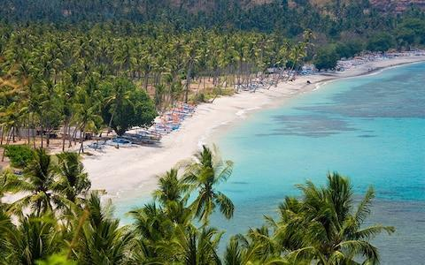 <span>Lombok is a quieter option to Bali</span> <span>Credit: Getty </span>