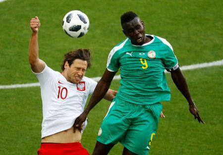 Soccer Football - World Cup - Group H - Poland vs Senegal - Spartak Stadium, Moscow, Russia - June 19, 2018 Poland's Grzegorz Krychowiak in action with Senegal's Mame Biram Diouf REUTERS/Kai Pfaffenbach