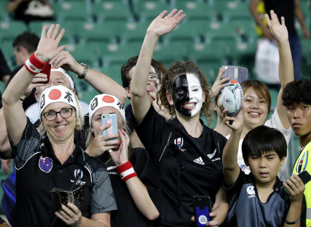 New Zealand supporters wave to the All Blacks following their Rugby World Cup Pool B game at Oita Stadium between New Zealand and Canada in Oita, Japan, Wednesday, Oct. 2, 2019. The All Blacks defeated Canada 63-0. (AP Photo/Aaron Favila)
