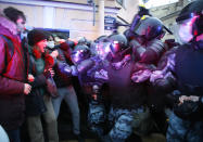 People clash with police during a protest in support of jailed opposition leader Alexei Navalny in St. Petersburg, Russia, Wednesday, April 21, 2021. A human rights group that monitors political repression said at least 400 people were arrested across the country in connection with the protests. Many were seized before protests even began, including two top Navalny associates in Moscow. (AP Photo/Dmitri Lovetsky)