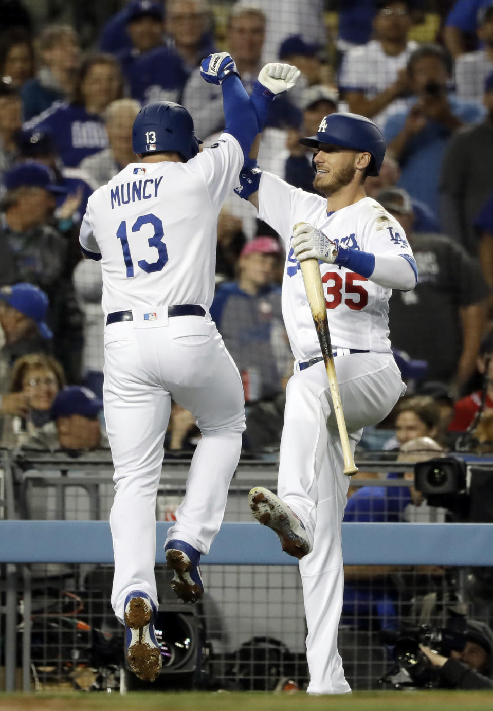Los Angeles Dodgers' Max Muncy (13) celebrates his solo home run with Cody Bellinger during the third inning of the team's baseball game against the Atlanta Braves on Wednesday, May 8, 2019, in Los Angeles. (AP Photo/Marcio Jose Sanchez)