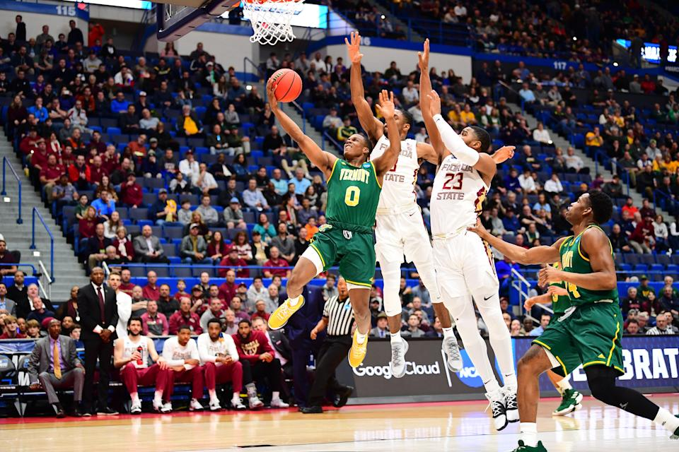 <p>Stef Smith #0 of the Vermont Catamounts drives to the rim against the Florida State Seminoles in the first round of the 2019 NCAA Men's Basketball Tournament held at XL Center on March 21, 2019 in Hartford, Connecticut. (Photo by Ben Solomon/NCAA Photos via Getty Images) </p>