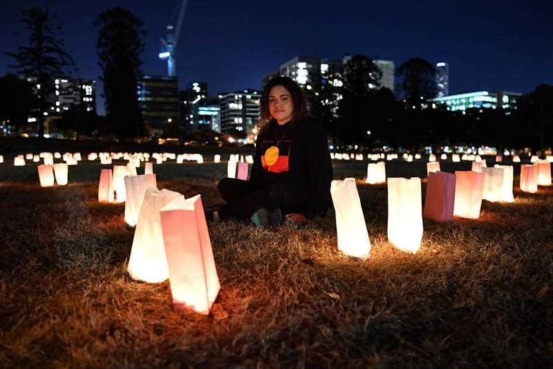 A Widjabul woman from the Bundjalung Nations, Larissa Baldwin, is seen during the candlelight vigil to protest against the deaths in custody of Aboriginal and Torres Strait Islander people held in Musgrave Park in Brisbane.