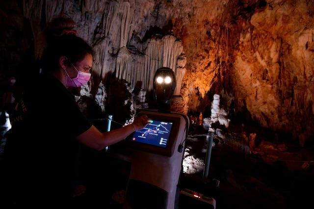 A guide programs Persephone inside Alistrati cave, north-east of Thessaloniki, Greece
