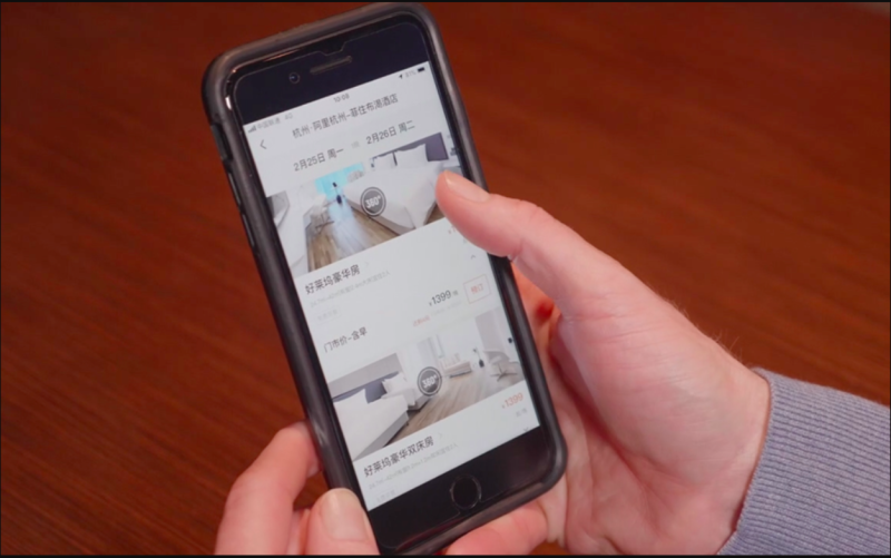 The FlyZoo app is shown on a smartphone.