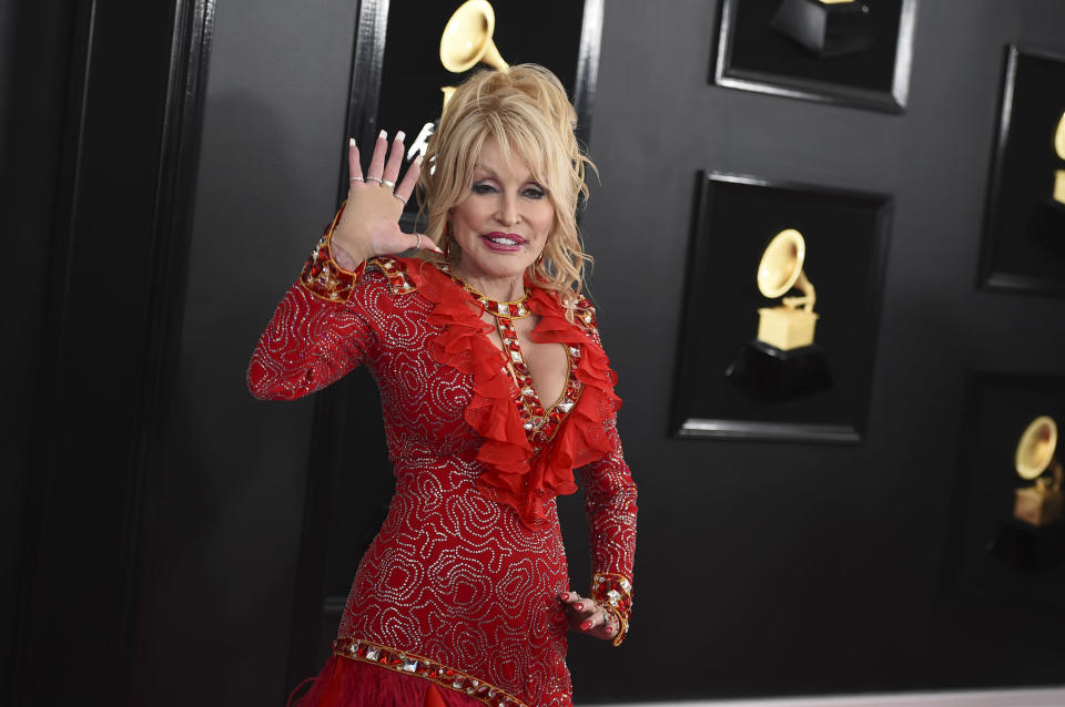 FILE - Dolly Parton arrives at the 61st annual Grammy Awards on Feb. 10, 2019, in Los Angeles. The Grammy-winning singer, actor and humanitarian posted a video on Tuesday, March 2, 2021, of her singing just before getting her COVID-19 vaccine shot. Parton donated $1 million to Vanderbilt University Medical Center in Nashville, Tennessee for coronavirus research. (Photo by Jordan Strauss/Invision/AP, File)