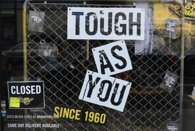 Window signage at a closed Dr. Martens store in the Brooklyn Borough of New York City