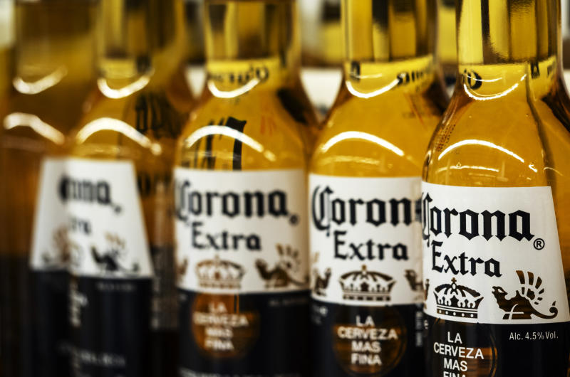 KIEV, UKRAINE - 2018/09/26: Detail of lined up Corona beer bottles seen on the store shelf. Corona extra Lager Beer is the flagship product of the Mexican company Grupo Modelo. (Photo by Igor Golovniov/SOPA Images/LightRocket via Getty Images)