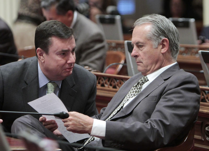 Republican state Senators Joel Anderson, of La Mesa, left, and Bill Emerson, of Redlands, confer during the Senate session at the Capitol in Sacramento, Calif., Thursday June, 14, 2012. Lawmakers are expected to vote on the 2012-13 state budget plan, Friday, to meet the constitutional deadline.(AP Photo/Rich Pedroncelli)