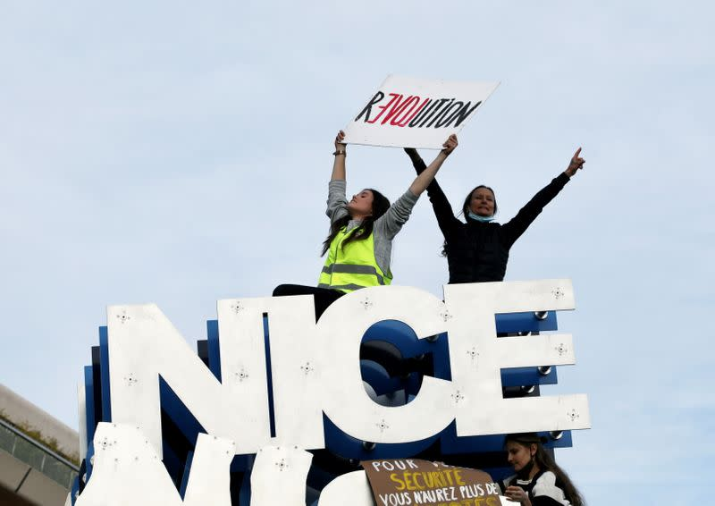 People attend a demonstration to protest against a bill that would make it a crime to circulate an image of a police officer's face, in Nice