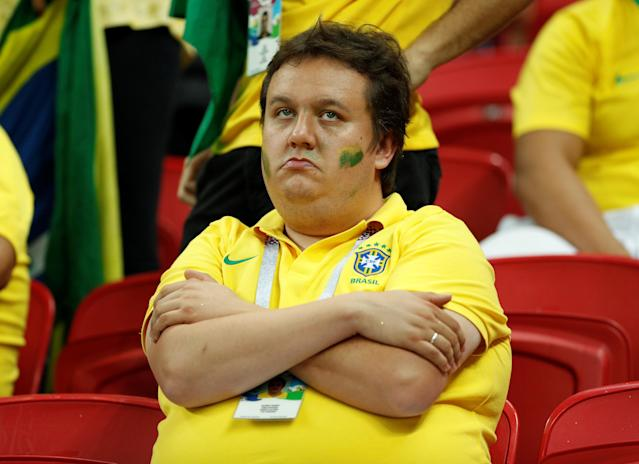 <p>Brazil fan inside the stadium looks dejected after the match REUTERS/John Sibley </p>